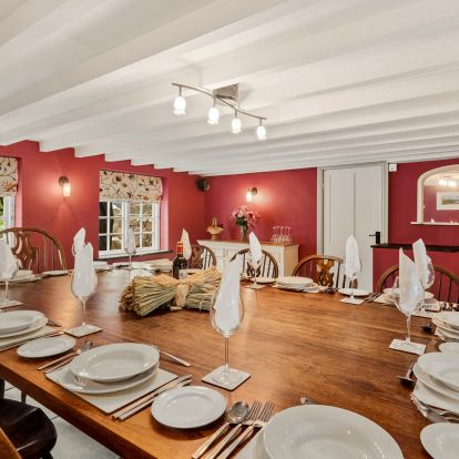 Dining room with wooden table and chairs