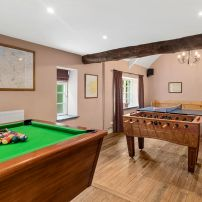 Games room with table tennis and football tables